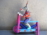 ウッドカービング 木彫り人形  [自転車に乗るシマウマ] オアハカ