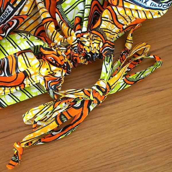 マリ 足踏みミシンで仕立てた パーニュ 巾着 エコバッグ(オレンジ模様)【画像4】