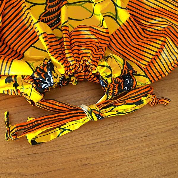 マリ 足踏みミシンで仕立てた パーニュ 巾着 エコバッグ(オレンジ 渡り鳥)【画像3】
