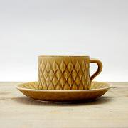 Relief Tea Cup And Saucer