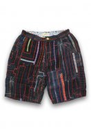 Mhon Patchwork Shorts