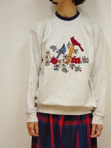 バードプリントのスウェットシャツ