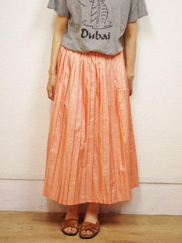 キラキラコーラルピンクのプリーツスカート
