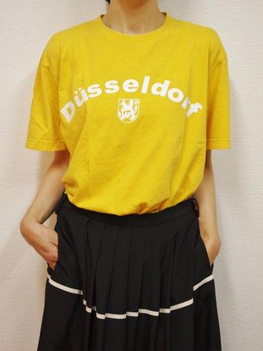 イエローのDüsseldorfのプリントTシャツ
