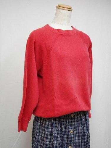 赤いコットンのラグランスウェットシャツ