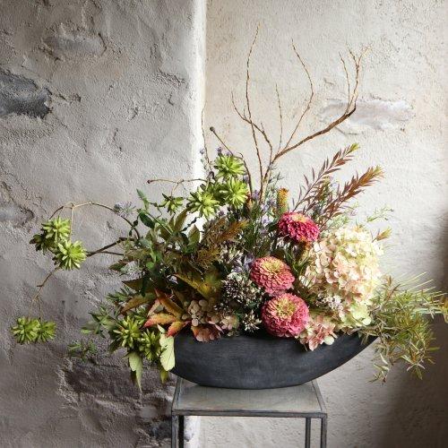 淡い色合いに秋の草花のアレンジメント。お祝いに・・・